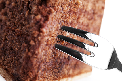 closeup of a fork in a chocolate cake