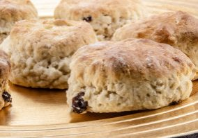 home made raisins scones on a plate
