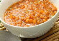 a white bowl of red lentil soup