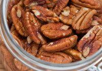 Fresh Pecan nuts in an open glass jar