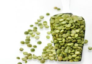 Dry Green Peas In A Measuring Spoon